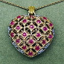 1.00CTW Genuine Ruby & Rhodium .925 Sterling Silver Heart Shape