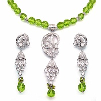 78.00 Grams White Cubic Zirconia & Light Green Glass Brass N