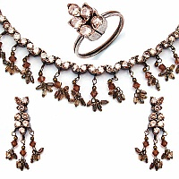 37.00 Grams Champagne Cubic Zirconia & Brown Glass Gold Plat