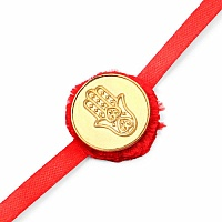 INDIAN TOUCH Gold Plated Brass Hamsa Symbol Embossed Coin Rakhi